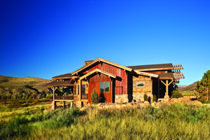 Boss-designed home with multiple reclaimed materials: red vertical siding - barnwood (not to be confused with the rusted metal applied vertically); horizontal siding - milled from mining timbers; fascia - barnwood; soffit - milled from pickle barrels