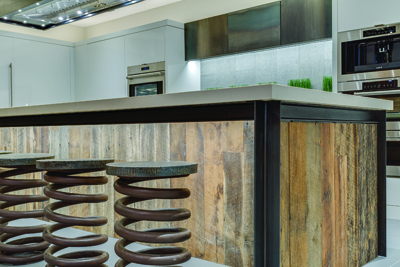 Peppertree designed and built kitchen island sided with reclaimed barnwood